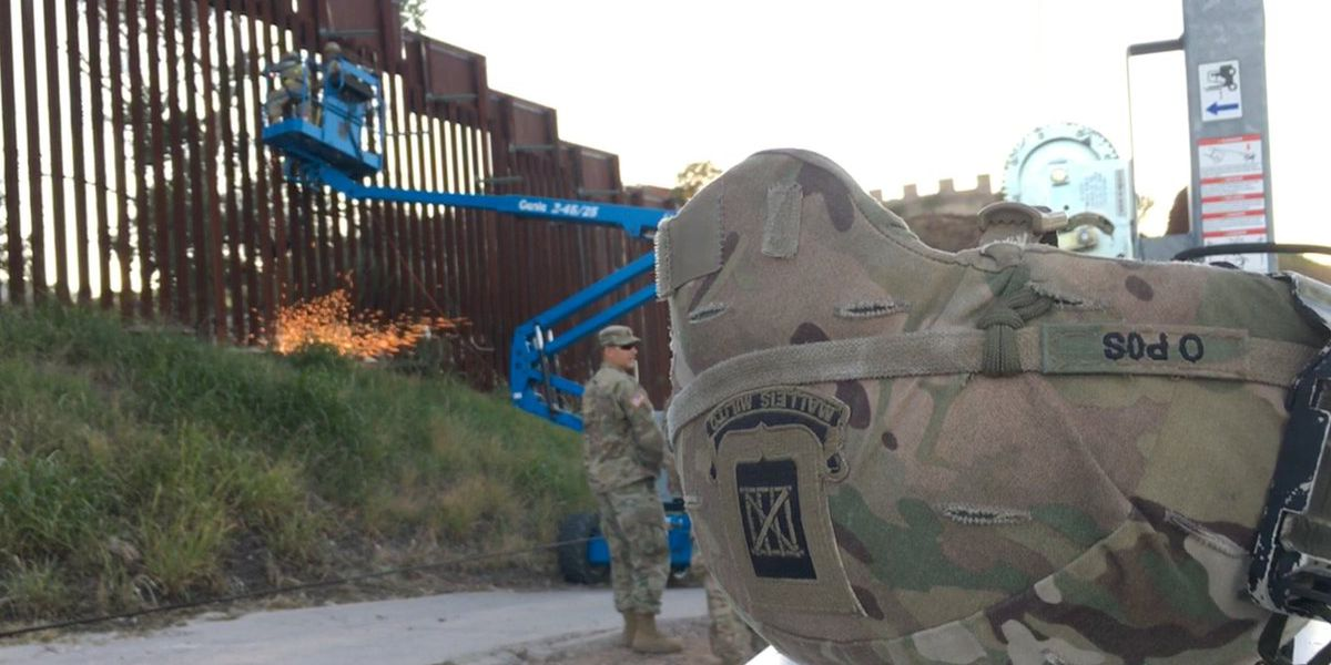 On chaotic day at border, fence reinforced by troops in Nogales