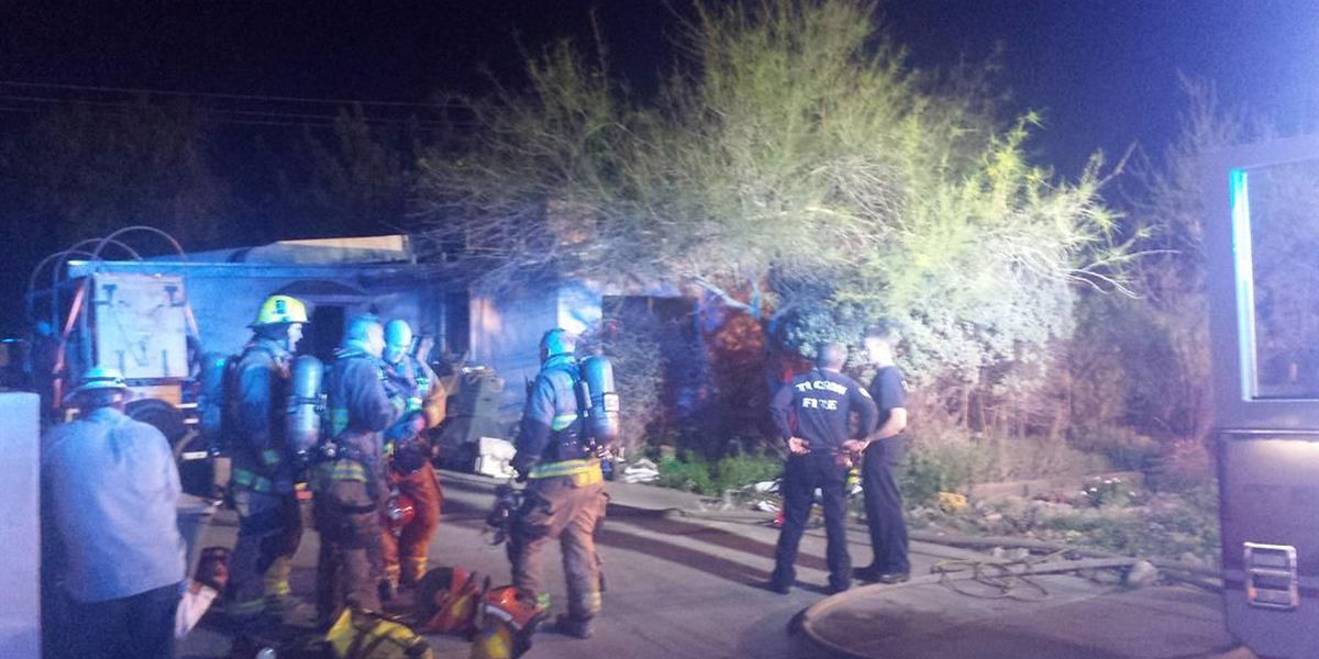 Dog dies, two people displaced in house fire
