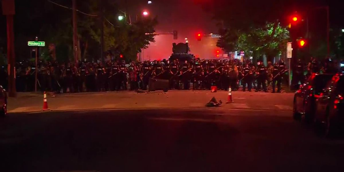 Tear gas and burning cars in US cities as unrest over police killings continues