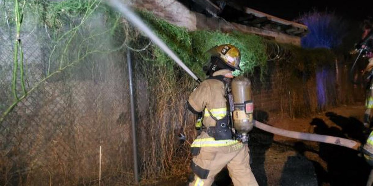 Firefighters extinguish fire in vacant building