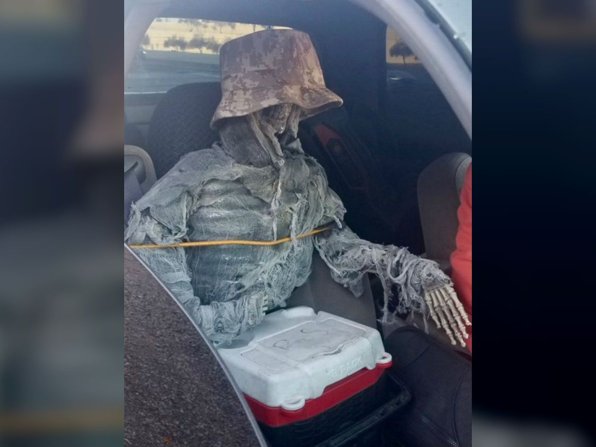 Driver uses camouflage mock skeleton as passenger near Apache Boulevard