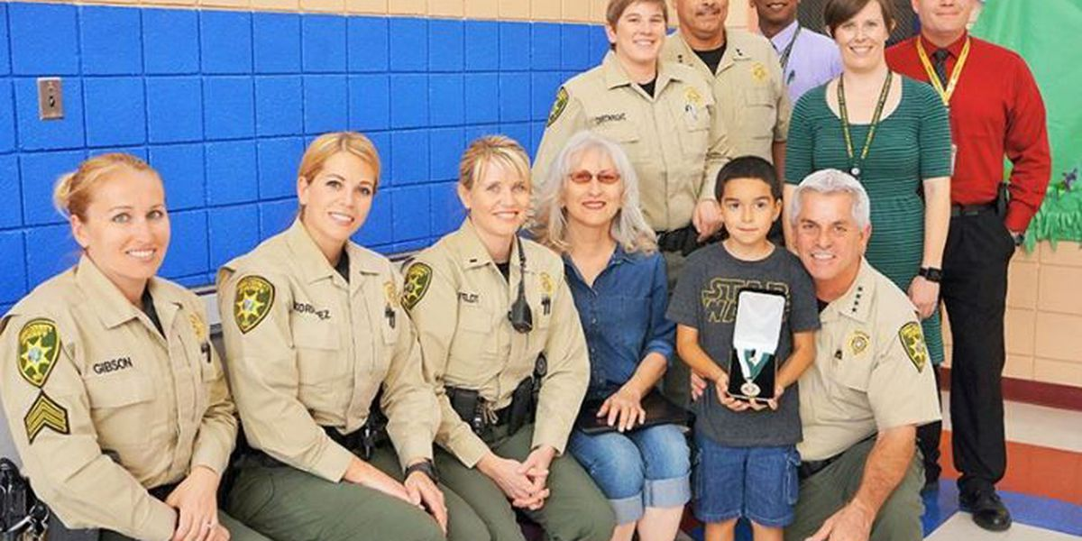 A 6-year-old Tucson boy receives the Sheriff's Citizen Medal for saving his grandmother's life