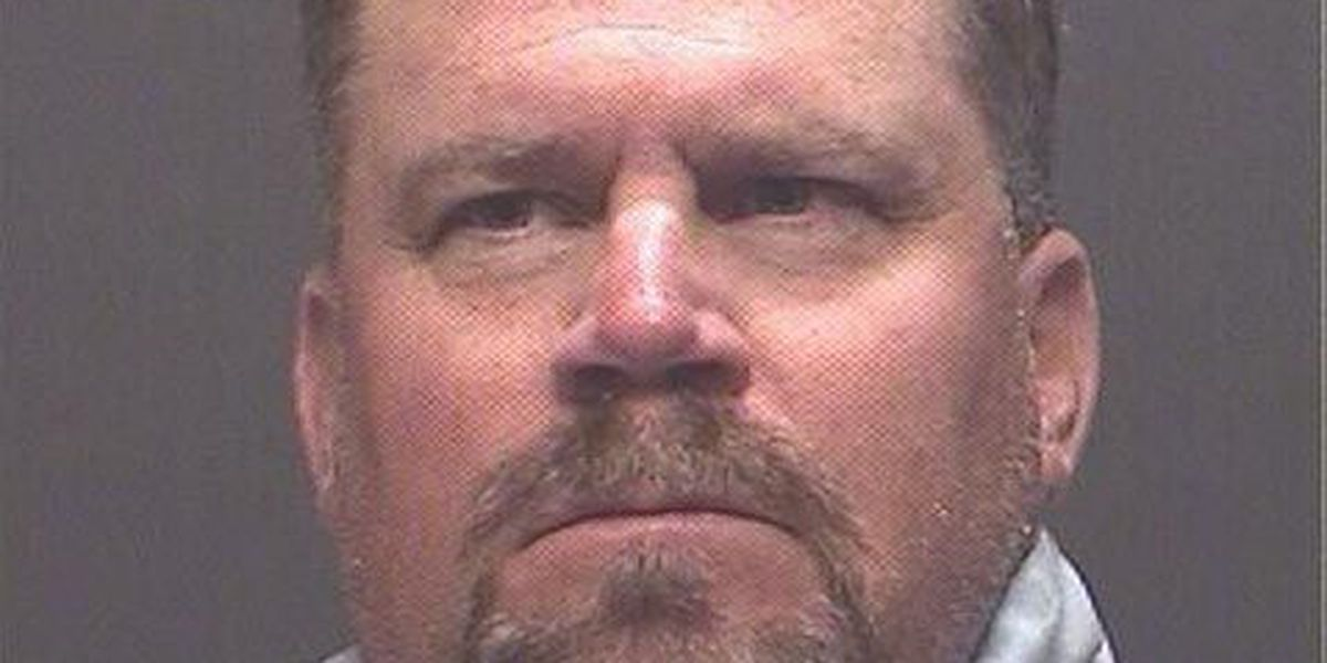 UA track coach faces domestic violence charges