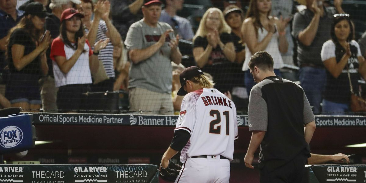 Greinke exits with abdominal tightness, D-backs rout Pirates