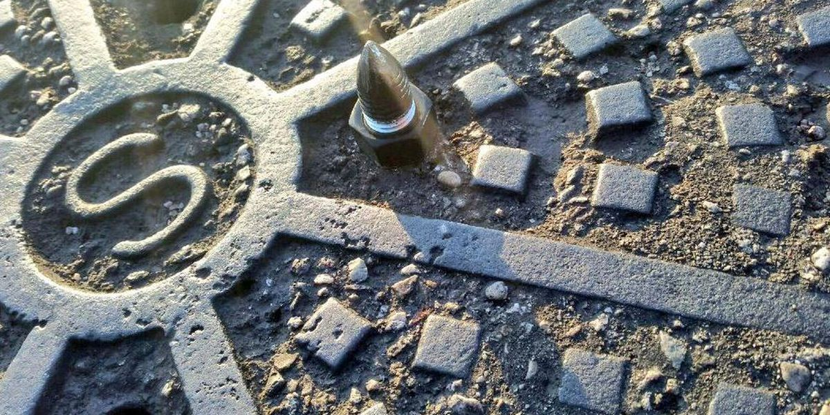 Spikes found again in manhole covers on the east side
