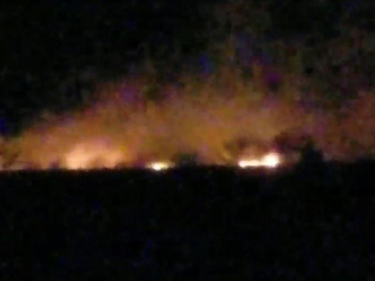 Brush fire burns west of Red Rock