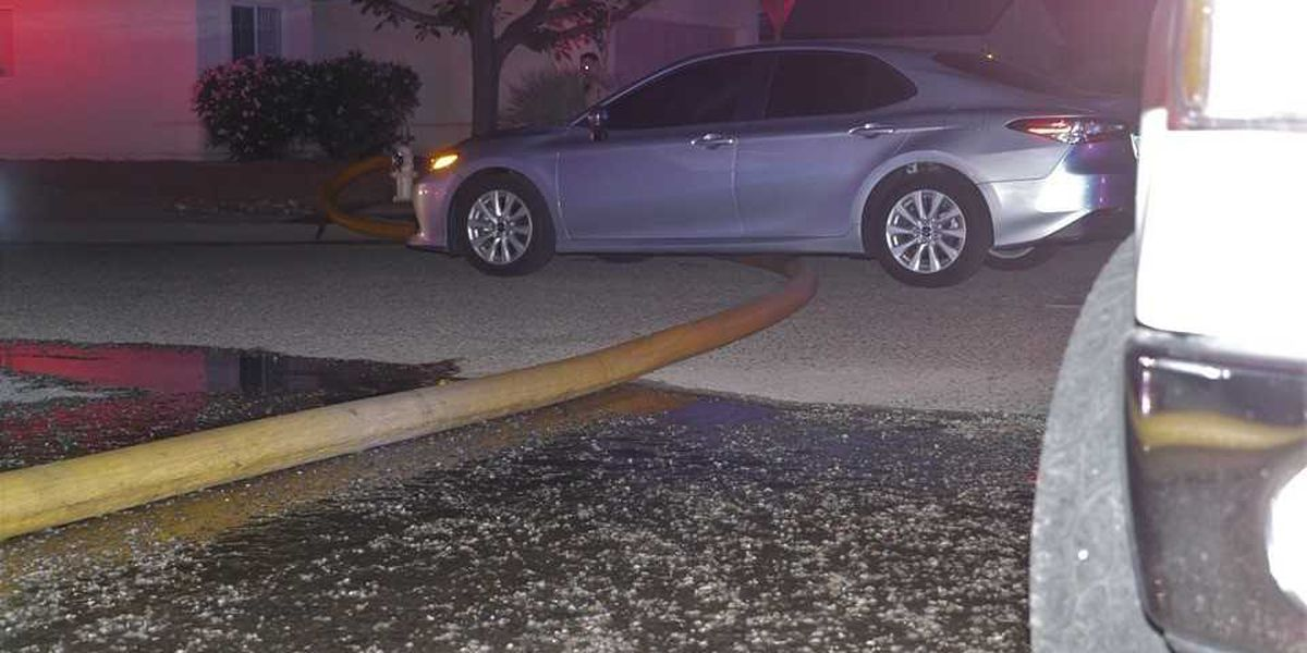 Car drives over water hose during firefighting operation