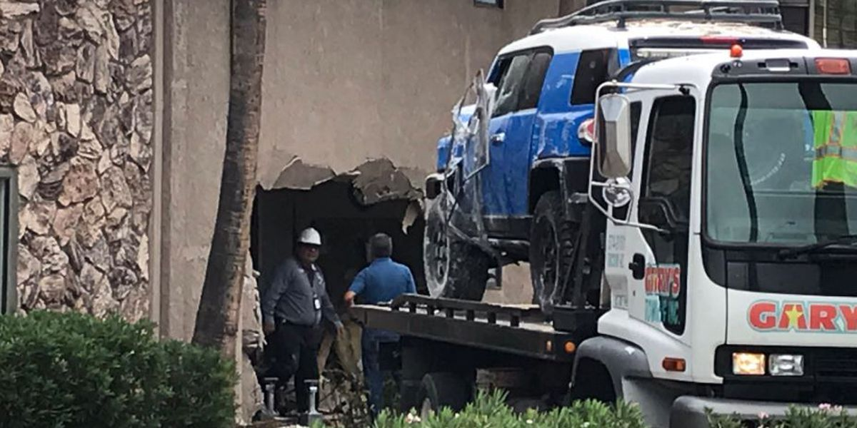 Driver cited after crashing into building