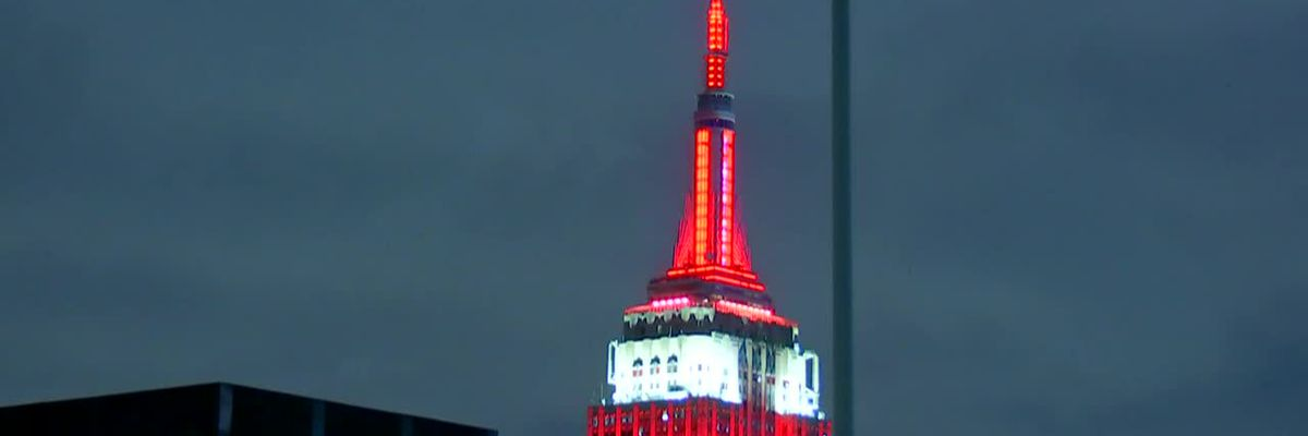The Empire State Building in New York City is lit up red for the Heisman Trophy winner