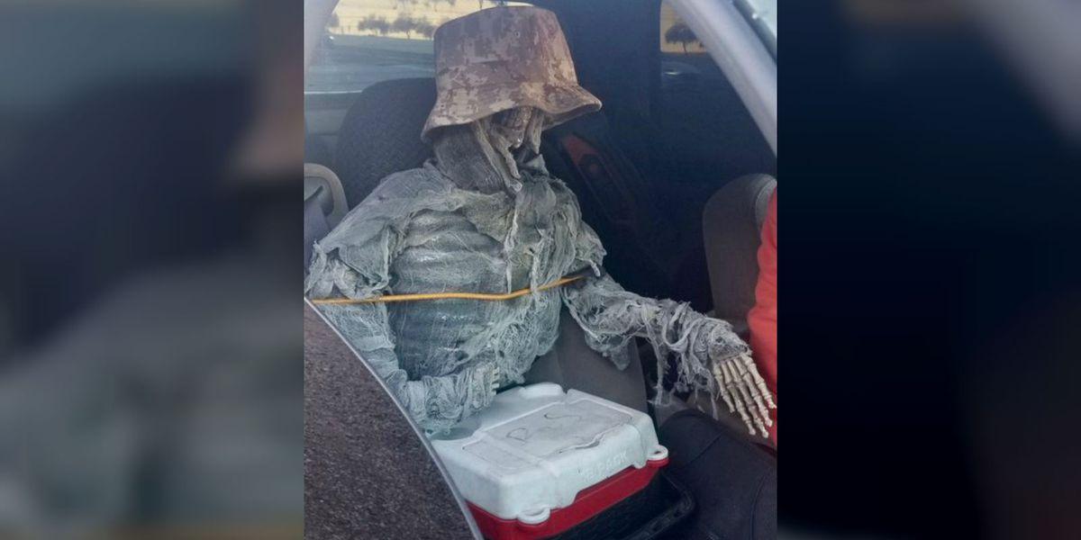 Driver uses camouflage mock skeleton as passenger near Apache Boulevard