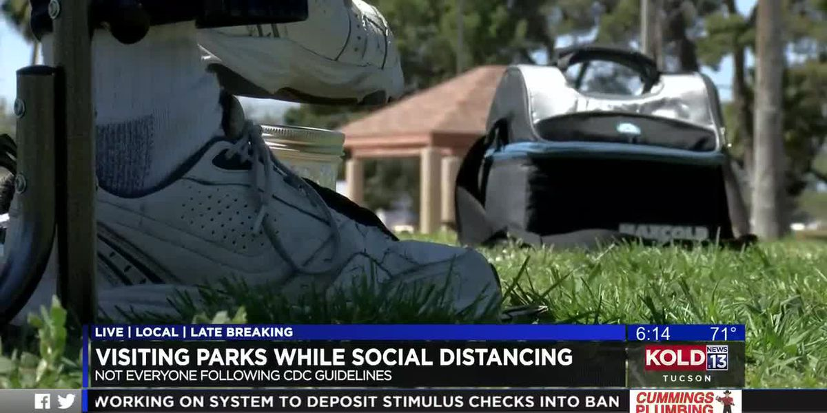 Practicing social distancing in public parks