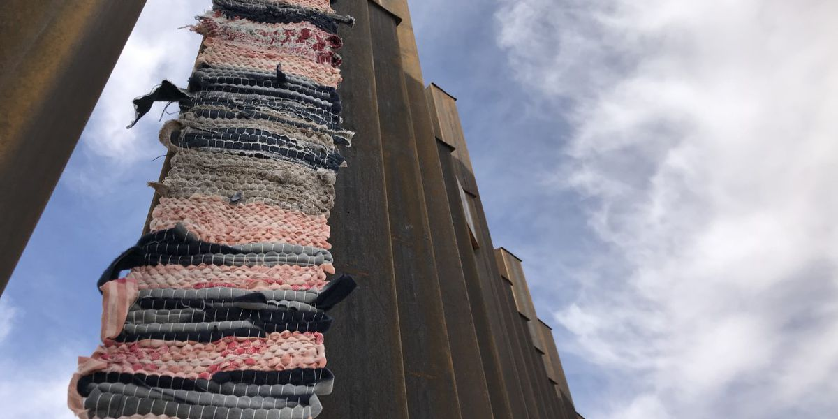 Tucson woman uses migrant clothing to protest border wall