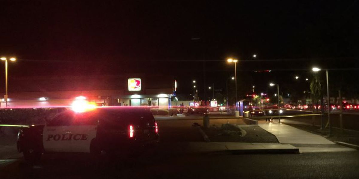 Police working a shooting at Jack in the Box on Grant and Oracle