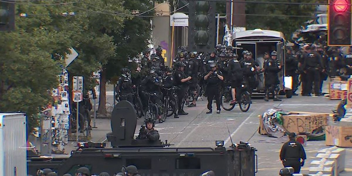 Seattle police forcibly clear 'lawless' protest zone