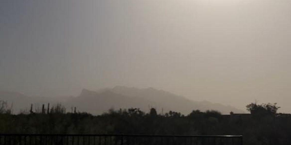 Wind-blown particulates block mountain views