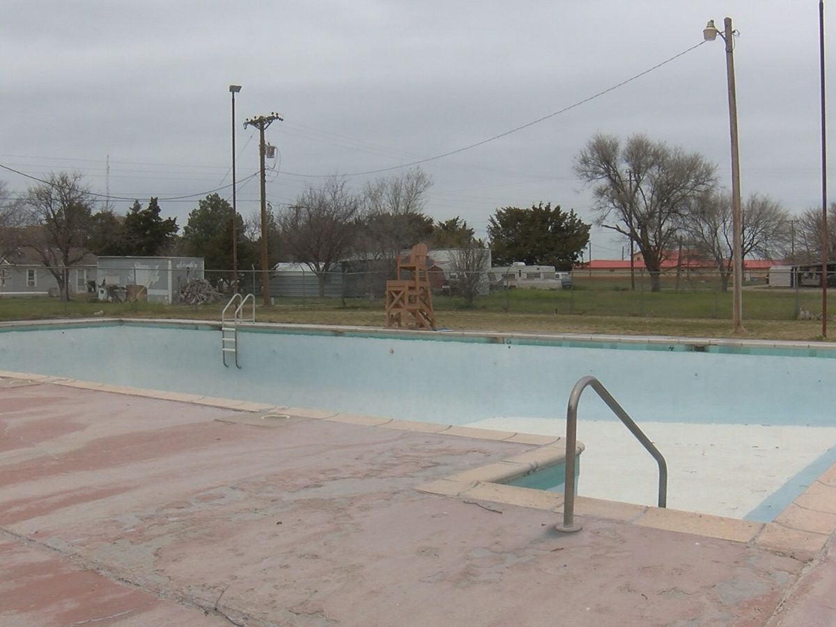 Woman rushed to hospital after being found at bottom of pool