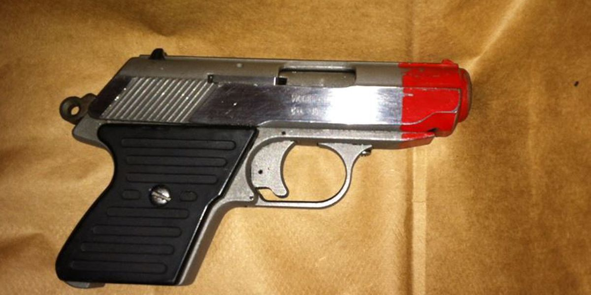 TPD: Suspect painted real gun to make it look like a toy