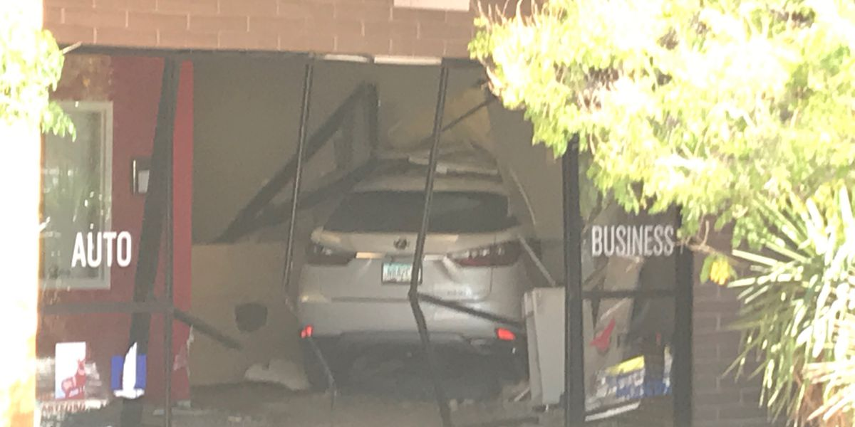 Three people suffer minor injuries after car crashes into business