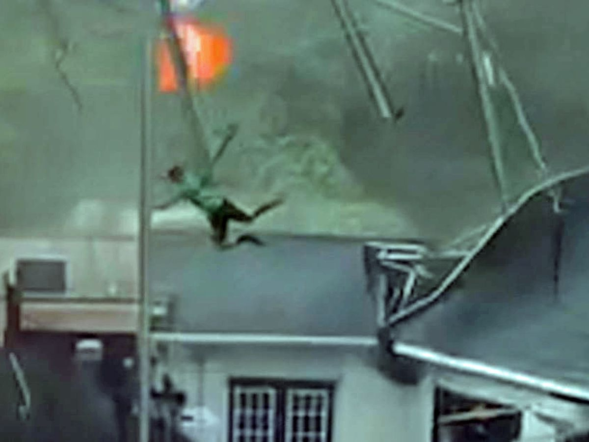 Caught on camera: Strong winds send restaurant workers flying into the air