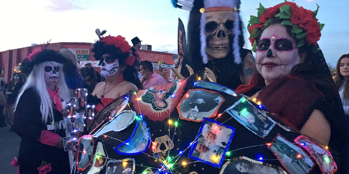 """""""It's hard to let them go."""": Thousands walk together in Tucson's All Souls Procession"""
