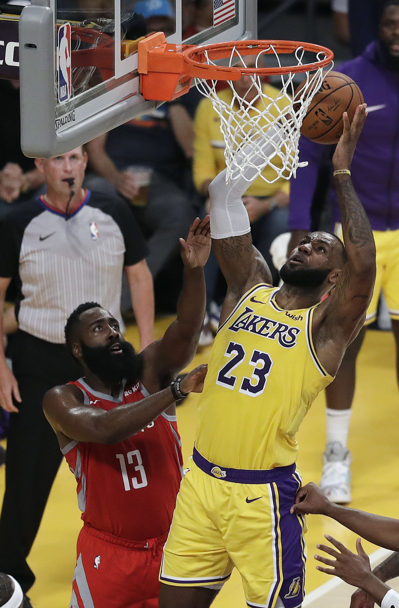 8792420b095 Los Angeles Lakers' LeBron James (23) shoots next to Houston Rockets' James