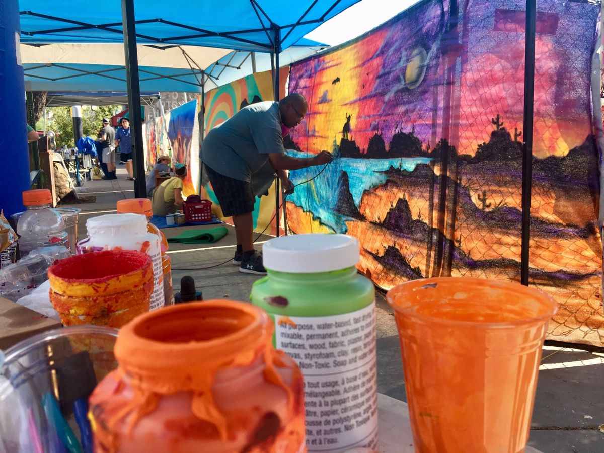 Artists create a colorful construction site on Fourth Avenue