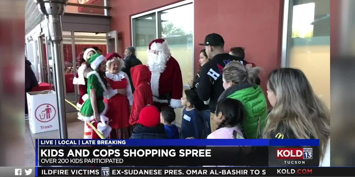 Tucson police help spread cheer, gifts with annual Kids and Cops event