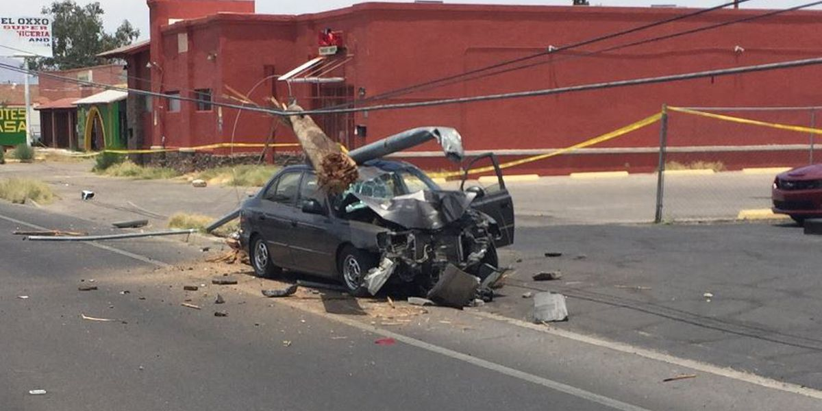 Car hits power pole; police close portion of 12th Avenue