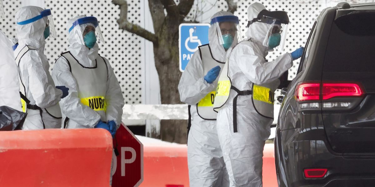 US cities brace for coronavirus spread; Spain's hospitals at breaking point