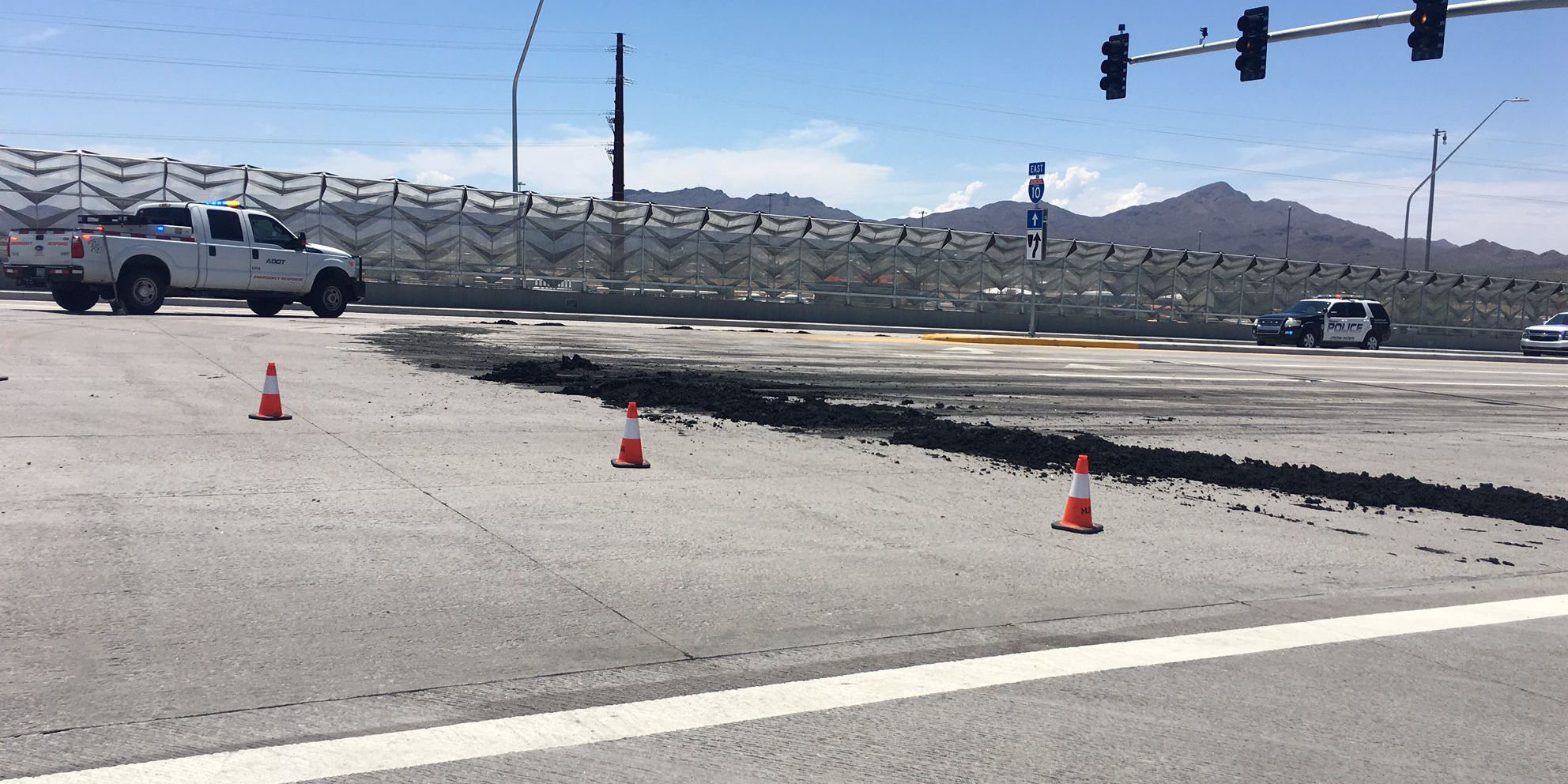 Portion of Ina Road overpass closes because of treated waste spill
