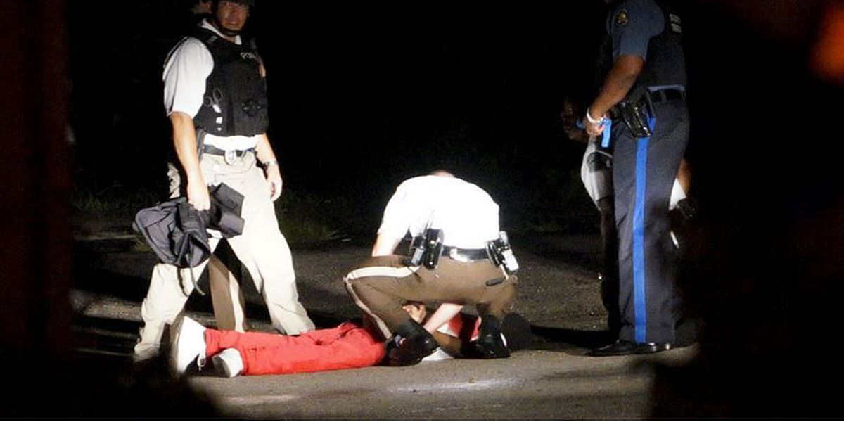 Police charge man they say opened fire on officers in Ferguson