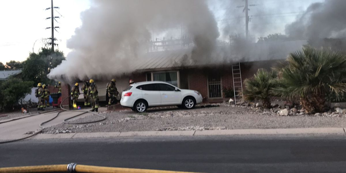 Firefighters keep early-morning garage fire from spreading to house
