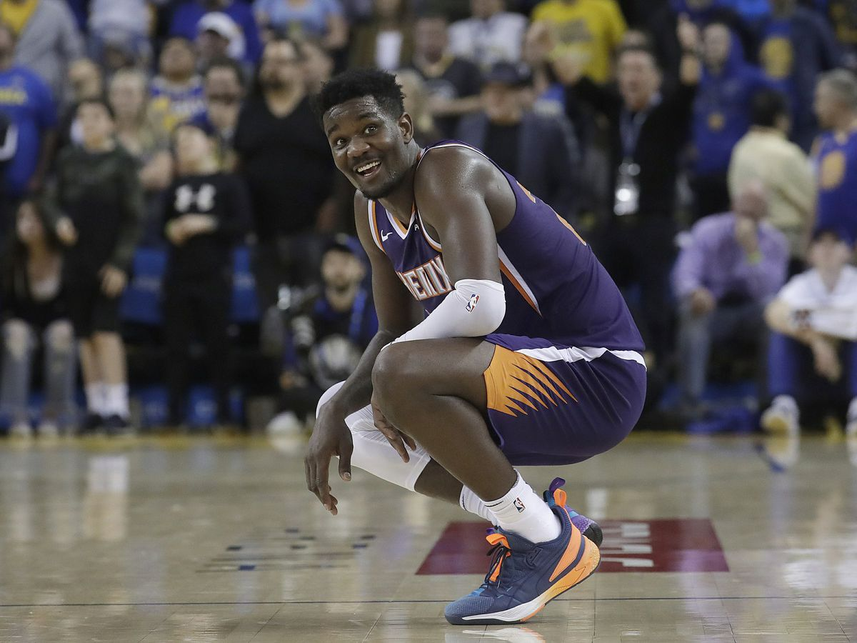 Booker, Suns snap 18-game skid to Warriors with 115-111 win