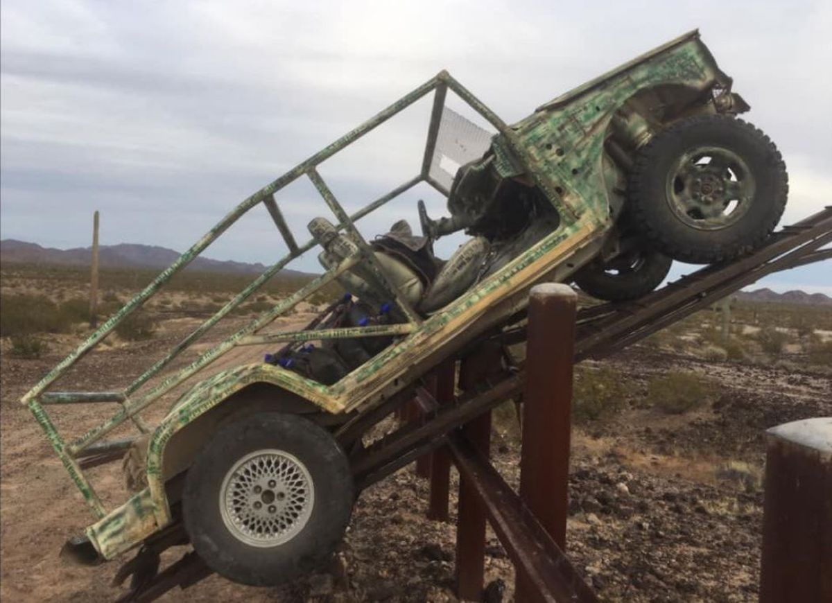 Jeep becomes stuck on border barrier, 11 people flee into Mexico