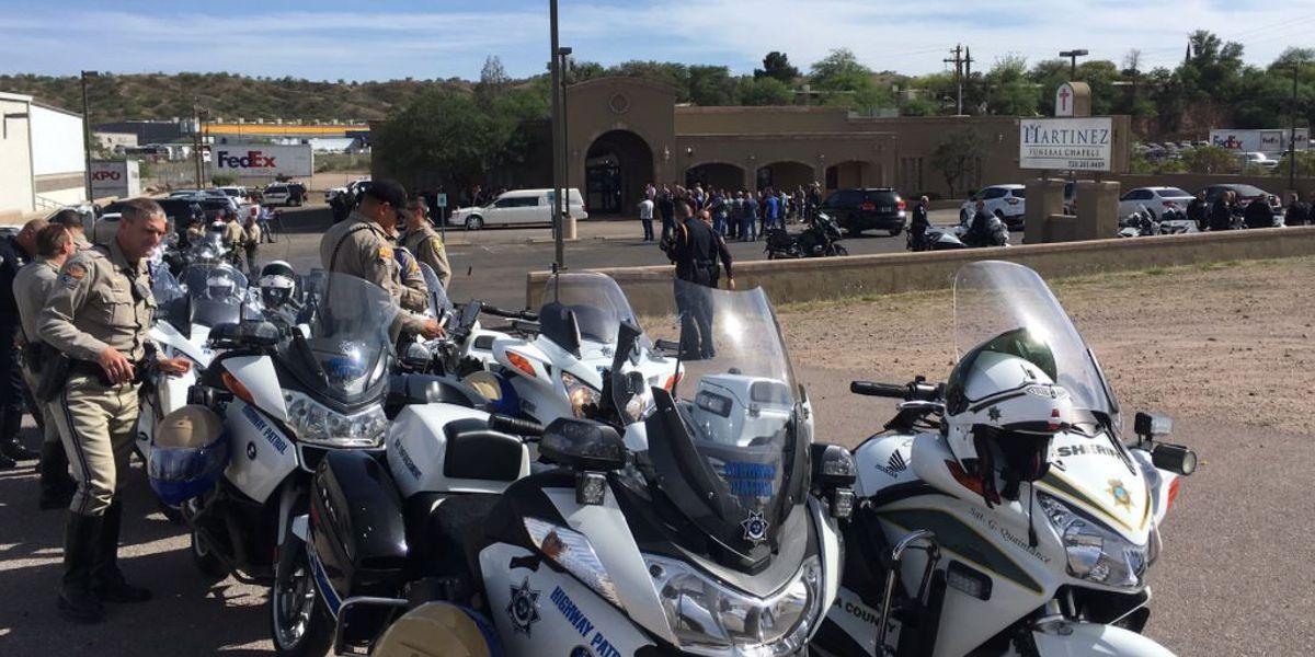 Motorcade escorts slain officer home to Nogales