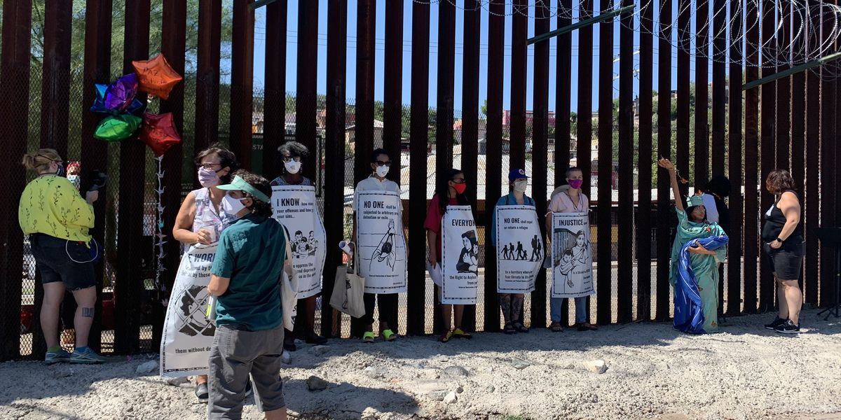 Protesters gather at border in Nogales in support of right to asylum