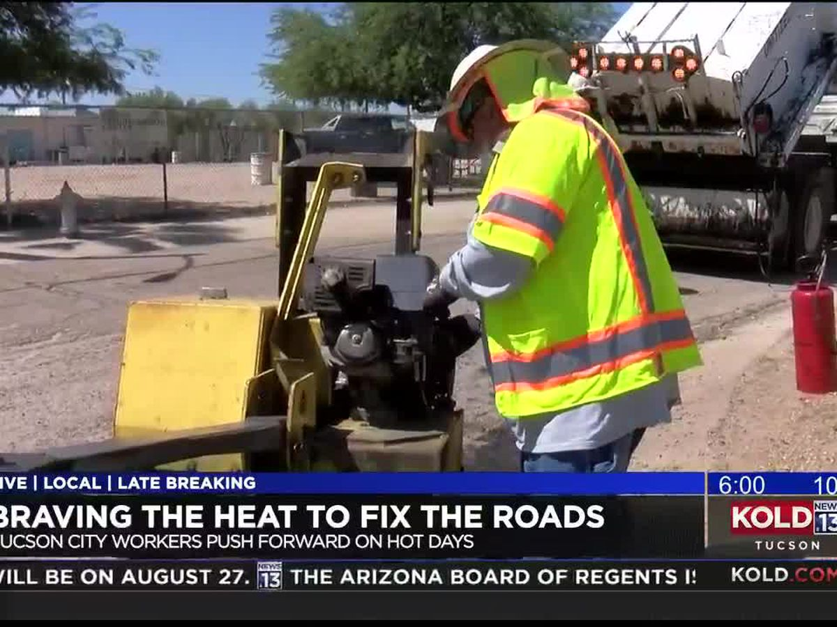 City workers work at beating the excessive heat