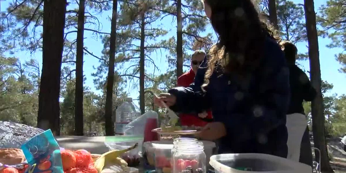 Families celebrate Thanksgiving Day outdoors to stay safe