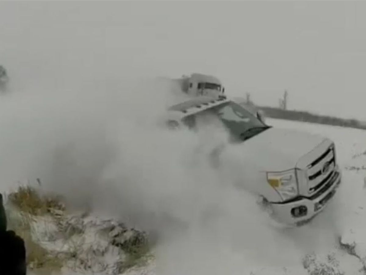 Iowa trooper, driver narrowly escape sliding truck